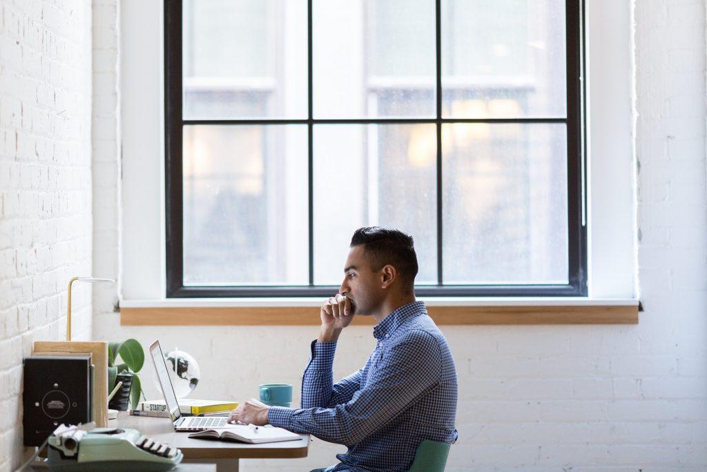 Man doing his R&D Tax Claim on his desktop